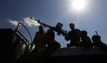 epa05068721 Armed members of Houthi militia are silhouetted against the sun as they guard during a parade on the eve of planned cease-fire and Geneva peace talks, in Sana?a, Yemen, 14 December 2015. A new round of peace talks between warring sides in Yemen will start in Geneva on 15 December, amid reports of a planned ceasefire by midnight 14 December. Saudi Arabia and fellow Sunni partners, including the UAE, have since March been carrying out a military campaign in Yemen against the Iranian-allied Houthis, who are fighting to oust internationally recognized President Abdo Rabbo Mansour Hadi.  EPA/YAHYA ARHAB